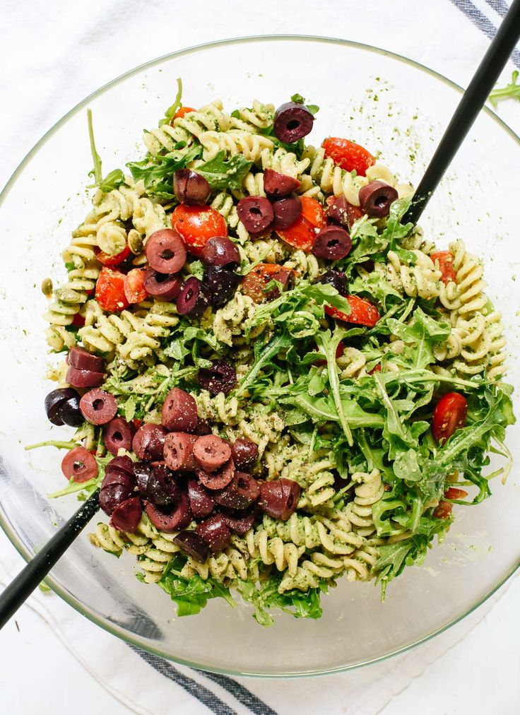 This pesto pasta salad recipe is bursting with bold, fresh flavors! It's light, healthy, and sure to please everyone. Vegan and easily gluten free. cookieandkate.com