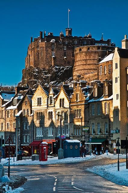 .Grassmarket in Edinbugh, Scotland. You claim a cathedral therefore I claim a Scottish town complete with a stone keep :P