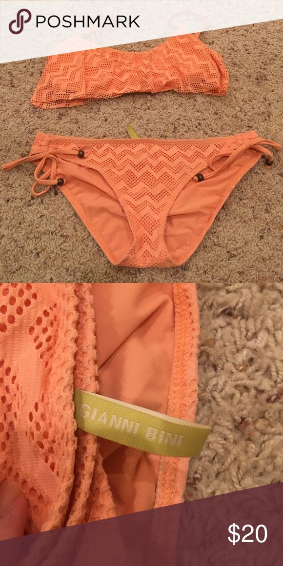 Light orange chevron bikini This is very cute and stylish! You will love it! The top is a size S and the bottoms are a M. Gianni Bini Swim Bikinis