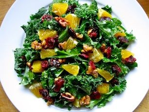 Kale citrus salad with dried cranberries and walnuts