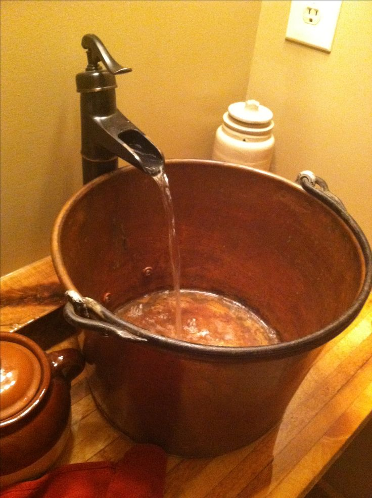 Bucket and water pump style faucet- for rustic half bath. Great idea for the diy toilet/ sink counter combo!