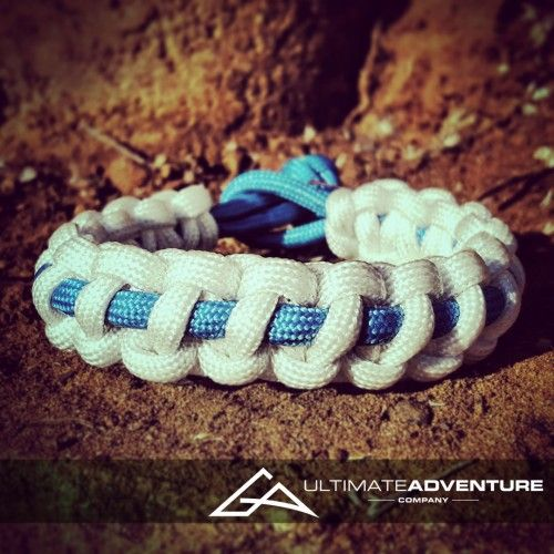 White with Sky Blue Supporter Band Paracord Survival Bracelet from www.ultimateadventures.co.za  #white #skyblue #blue #sharksjawbone #jawbone #bracelet #paracord #paracord550 #paracordsurvival #paracordsurvivalbracelet #survival #paracordporn #outdoorgear #survivalbracelet #survivalparacord #survivaladventure #edc #everydaycarry #adventure #survivalgear #adventuregear #adventurebracelet #ultimateadventure #ultimateadventureco #ultimateadventures #paracordon #cordcraft #craft #outdoorcraft