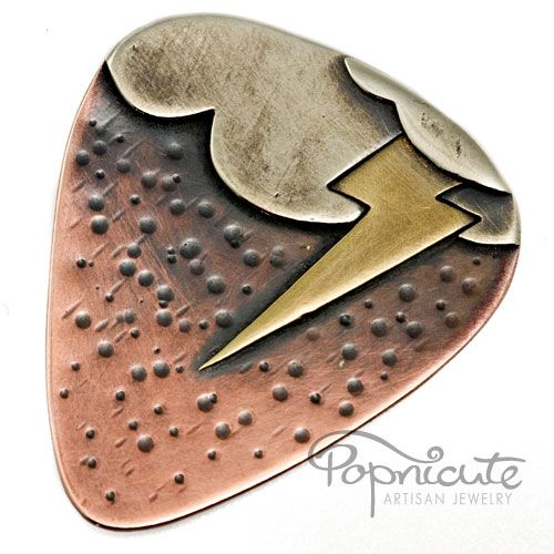 A unique metal guitar pick with lightning, cloud, and rain storm design. This design is called: Stormy Summers.  This guitar pick is handmade from scratch using copper as the pick with argentium silve