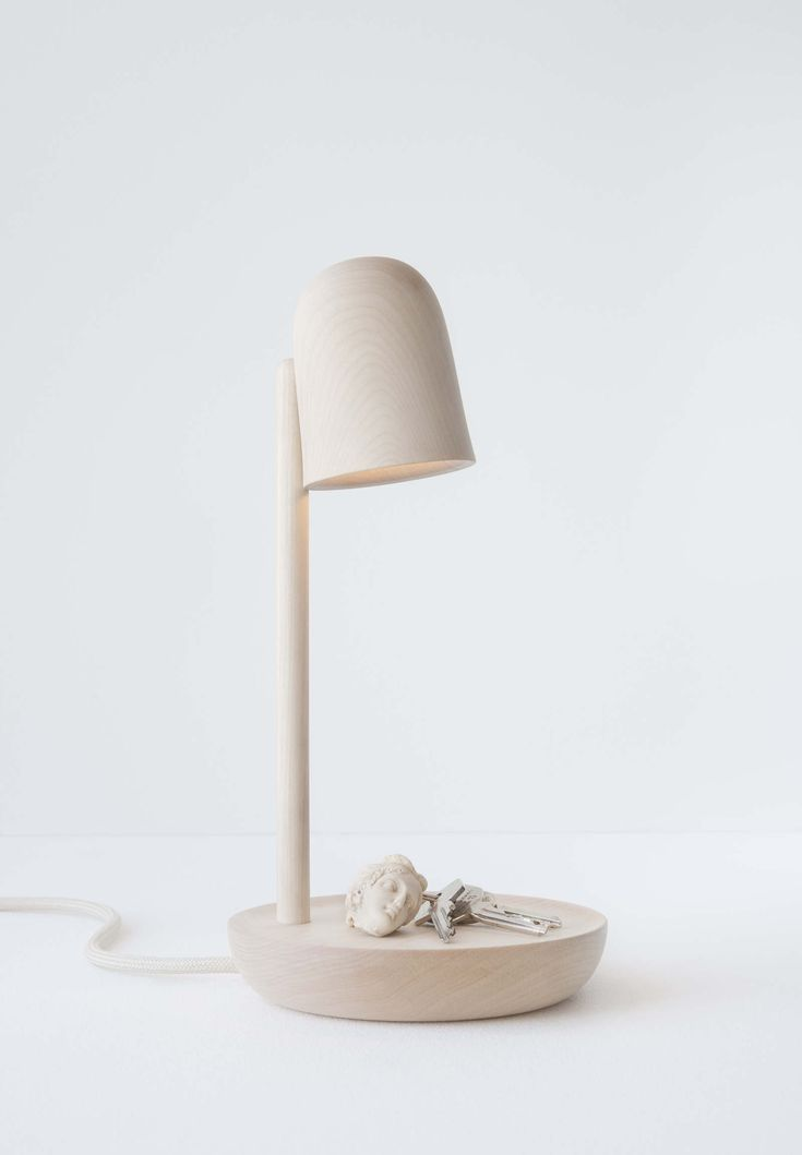Piedistallo  The Piedistallo is a lamp that functions as a pedestal showcasing any given object placed on the lamp foot surface, making it a personal light of display.   Material: Birch wood Dimension: ø 160 mm, height 290 mm  Prototype ...
