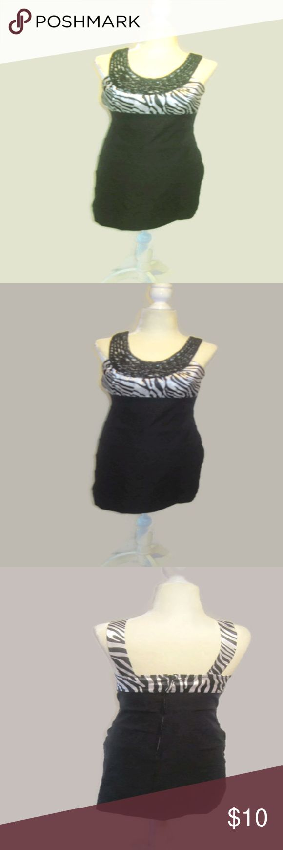 """Trixxi Zebra Print Beaded Cocktail Dress Trixxi Cocktail Dress Women's JR Size 5 Black and White Slim Fit Silhouette  High Quality Spandex Blend Bottom that Stretches and Fits to your Shape with Shutter Pleats   Built in Bra  Above Knee Mini  Animal Print White Satiny Top with Bead Embellishments  Halter Back   Half Zip Up  Slim Fitting Sexy Dress!!   Junior Size 5 Approximate  Sizing Bust 34-36"""" Waist 26-28"""" Hips 35-37""""   Sexy Dress!!  Smoke Free Environment Trixxi Dresses"""