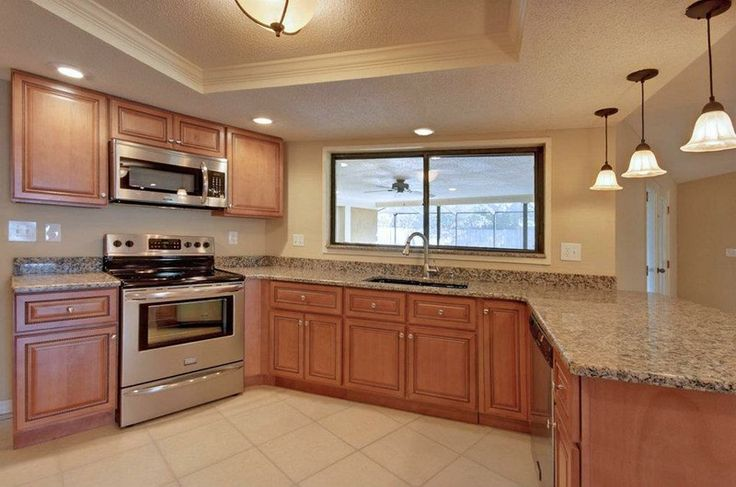 what color kitchen appliances are in style marquis cinnamon kitchen with stainless steel appliances 9835