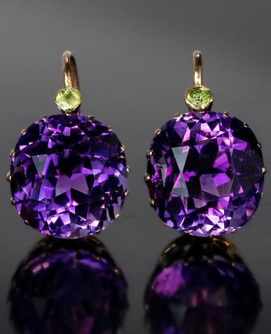 Antique Russian Siberian Amethyst and Demantoid Earrings made in St. Petersburg between 1899 and 1904 The 14K gold earrings are prong-set with two exceptional Siberian amethysts. It is very rare to see a pair of perfectly matched Siberian amethysts of that size: 14 x 13 x 11 mm (approximately 11.67 ct) and 14 x 13.1 x 11.2 mm (approximately 11.98 ct).
