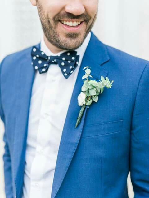 Groom in bright blue suit and polka dot bow tie.
