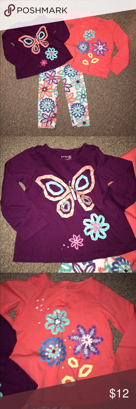 Double Floral Outfit First Impressions size:24m white pants with large blue, plum, teal, and coral colored flowers matched with long sleeved plum shirt with a butterfly and flowers and a long sleeved coral shirt with flowers First Impressions Matching Sets