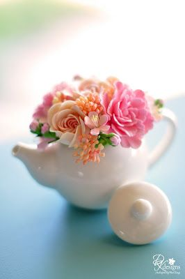 Completed this custom mini teapot of miniature peonies, English roses and plum blossoms in pinks and peaches.