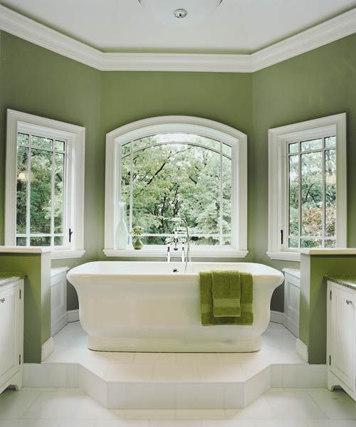 Aarchitect Carol Kurth's plan hinged on a modest bumpout—about 8 feet deep and 10½ feet wide... tub, positioned to maximize Hudson River views... Shown: On a platform in the new windowed bay, a Waterworks tub soaks up natural light and scenic vistas via Kolbe windows.