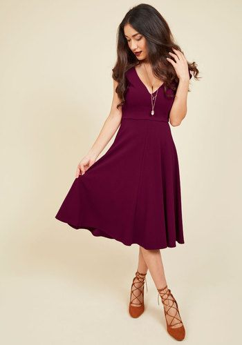 When your love offers to take you anywhere you wish, you let this rich berry dress dictate the flavor of the evening. Its sweetheart neckline, princess seams, and cute cap sleeves could mean anything from a romantic dinner to dancing lessons!