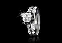 A modern take on a classic engagement style. Two sterling silver bands encrusted with diamonds and black diamond edging.