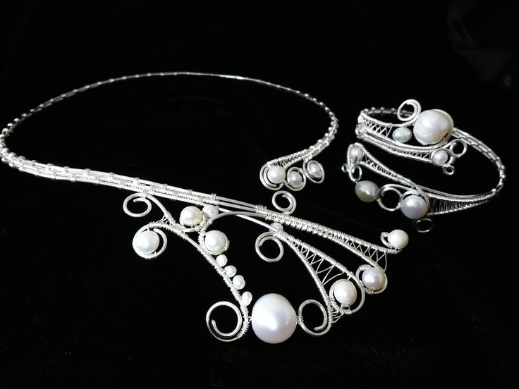 Wire wrapped, handmade collar and bracelet, adorned with freshwater pearls.