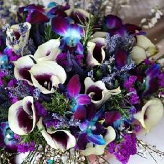 I love this! blue and purple orchids And picasso lilies with the purple inside.
