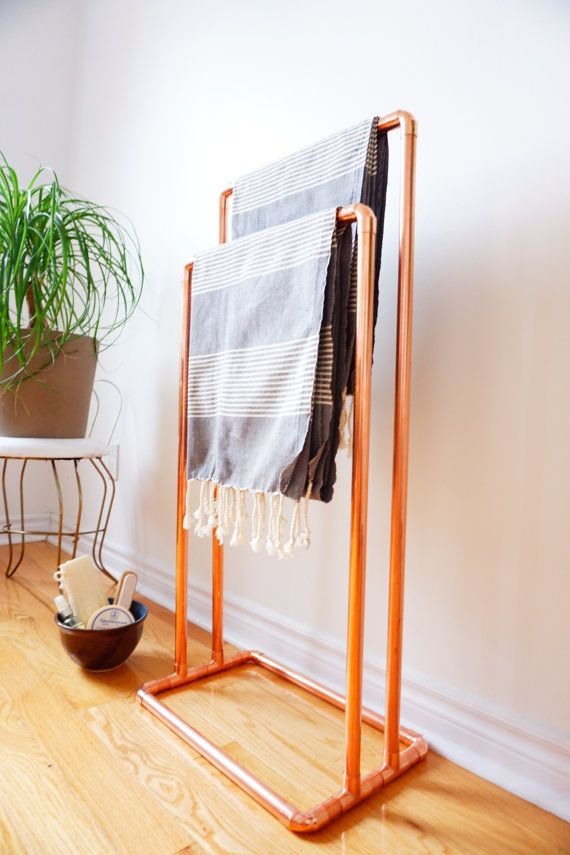 This versatile free-standing copper rack can be used to display towels, blankets, quilts, etc. The open design and bright copper components create a
