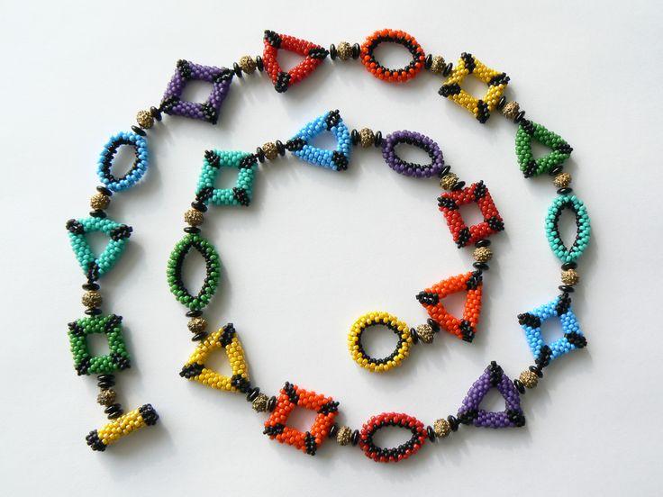 Color wheel - circular peyote variations.  Japanese seed beads, brass spacers.