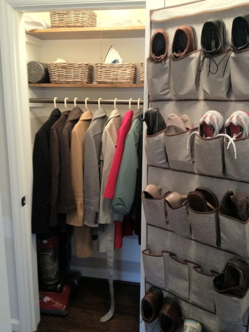 Great example! Closet isn't full; lots of visible floor space; baskets to conceal small items.