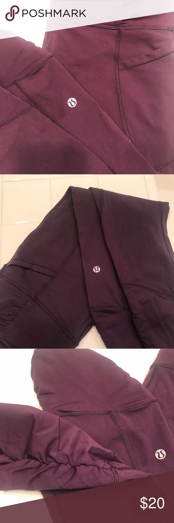 Women's lululemon athletica Purple crop pants Great material size 8 these are worn and used is a low rise waste cropped pants With detailed fabric around the bottom Pants Capris