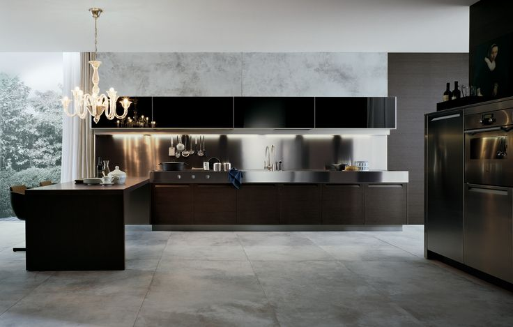 Varenna_Minimal wih doors in grey oak, tall units in stainless steel, steel worktop thickness 160 mm, peninsula in grey oak. Wall units with flap opening in nero glossy lacquered glass.