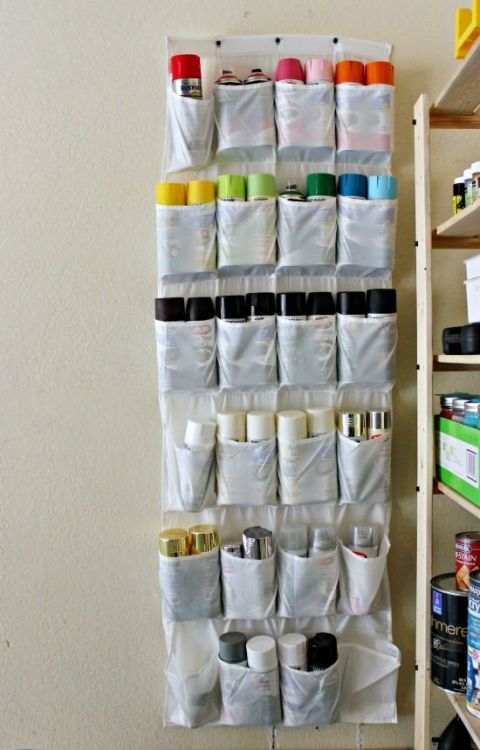 Say you invested in a rainbow of colors for a project, but have no where to keep them. Use hanging storage to make better use of empty wall space in your garage.Get more hanging shoe organizer ideas at HouseBeautiful.com.