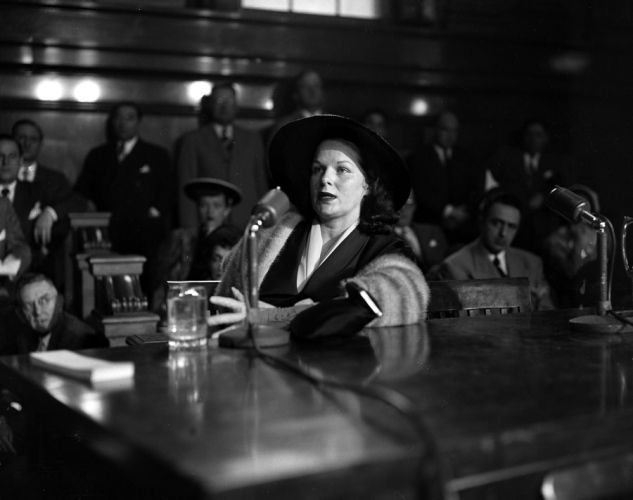 """Virginia Hill, also known as the """"queen of the gangster molls,"""" was the girlfriend of Brooklyn-born mobster Bugsy Siegel. Here she testifies at the 1951 Kefauver hearings in an investigation about the extent of organized crime."""