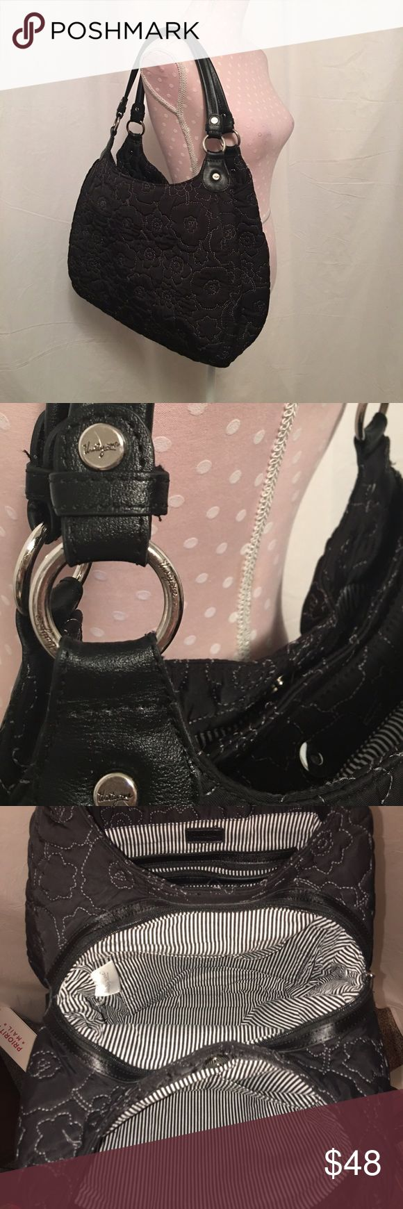 Thirty One Avenue Black Quilted Poppy Handbag EUC! Thirty-One 5th Avenue Shoulder Bag.  Quilted poppy in black with leather handles.  This bag consists of three sections: one zippered area (center) and two with magnet closures. There is a large zippered pocket inside one section and two open pockets in the other two sections. The bag is approx. 15 inches wide and approx 11 inches tall. thirty one Bags