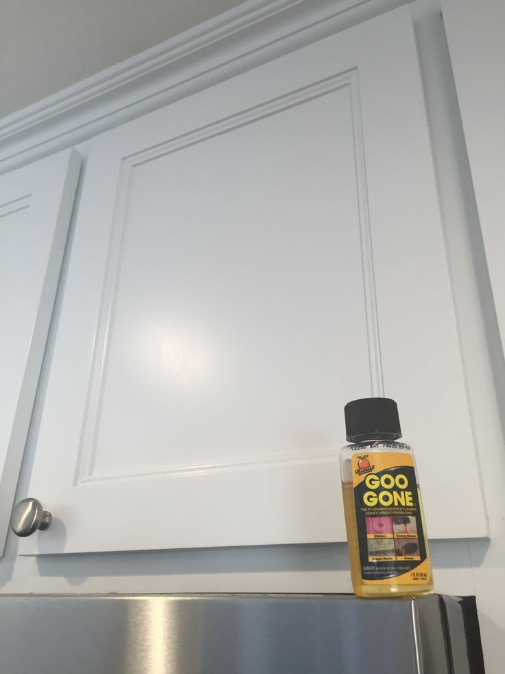 Remove kitchen cabinet grease like a miracle!  Goo Gone!!! The absolute best!