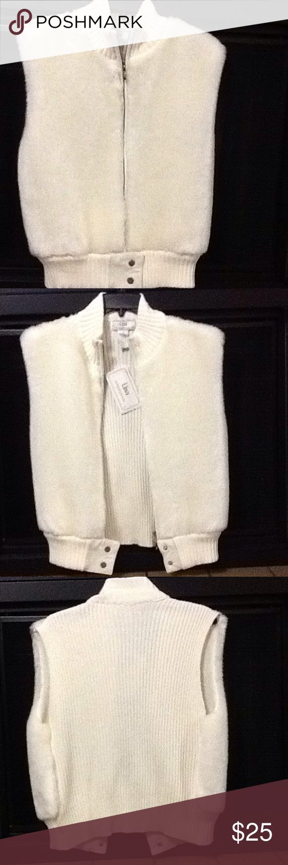 Women's White Faux Vest. Soft Faux fur to a cable knit in white leather for bottom trim. Much prettier than photos. Shoulder to shoulder  Seventeen and half inches wide Armhole to Armhole nineteen inches wide. Length 24 inches . Lisa International Jackets & Coats Vests