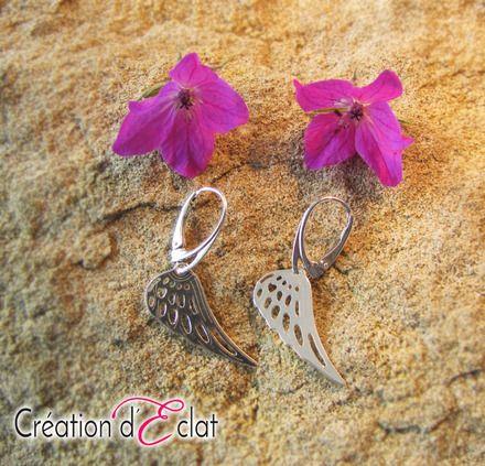 Boucles d'oreilles en Argent 925 composées : d'une Dormeuses et d'un pendant en forme d'aile d'une hauteur de 2.5 cm   Hauteur du modèle : 4 cm Largeur : 1 cm  Création A - 19072416