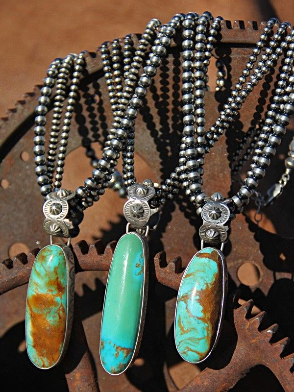 Beautiful beaded necklaces and turquoise pendants.