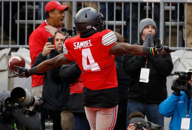 Curtis Samuel Photos Photos - Curtis Samuel #4 of the Ohio State Buckeyes scores the winning touchdown in double overtime against the Michigan Wolverines at Ohio Stadium on November 26, 2016 in Columbus, Ohio. - Michigan v Ohio State