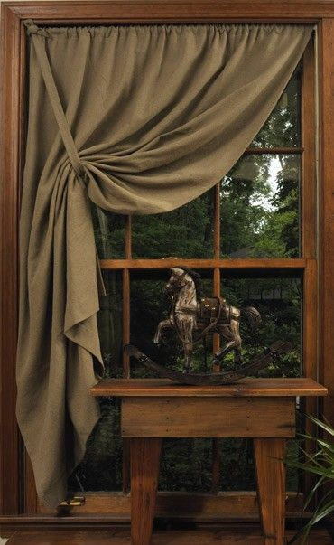 DIY CURTAINS & SHADES :: Simple window covering (Shaker pullback curtain) that uses half as many panels per window. @ Home Improvement Ideas Stealing the tieback idea
