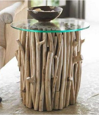 from La Bioguia. Mesita base hecha con troncos  Coffee table base made from branches.