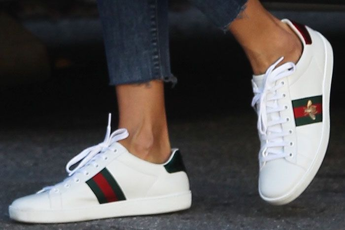 "Alessandra goes for the low-key bee embroidery on her Gucci ""Ace"" sneakers"