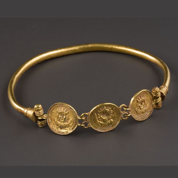 Byzantine Braided Gold Necklace with a Medallion representing Fortune and Bellerophon A Bracelet with Pseudo-Medallions. Culture : Byzantine. Period : 6th century CE