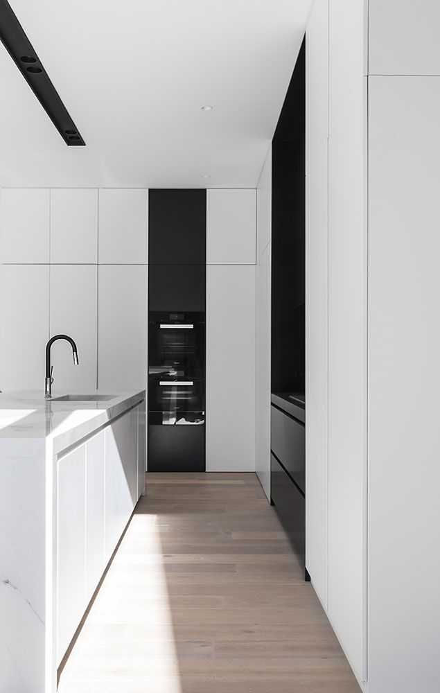 Kooyongkoot Road Residence is a minimal, three-story home with a compact design located in Hawthorn, Australia, designed by B.E Architecture.