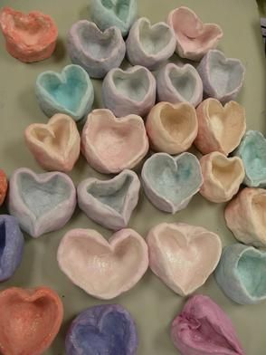 heart-shaped pinch pots students at carl a. furr elementary school made and donated to a hospice in memory of one of their teachers.