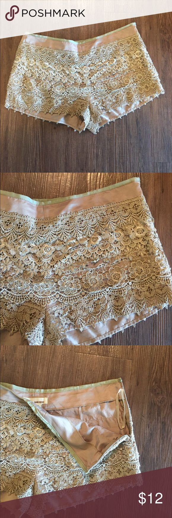 "Sans Souci Large Lace Light Tan Shorts Sand Souci large lace light tan shorts. They are very cute and versatile with any summer wardrobe.  It has a left side zipper that is 5"" long, a 34"" waist, and is 20"" down from the waist. These do not have any stretch to them. No defects seen and from a smoke free home. Sans Souci Shorts"