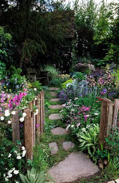 Cottage garden - Rough fence (Permanently opened gate?), sunken path, feathery flowers