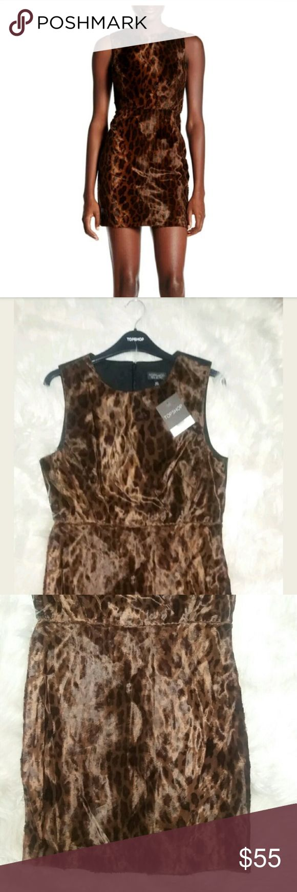 TOPSHOP Sleeveless Leopard Vegan Fur Mini Dress 8 TOPSHOP NEW Black Brown Sleeveless Leopard Faux Fur Mini Shift Dress US Size 8-  Sleeveless Originally $115. Back zip with hook with eye closure . Sheath silhouette  Allover faux fur print and texture . Fast shipping same or next business day Measurements Flat: 33in  length    Fiber Content  Shell (faux fur): 47% cotton, 40% viscose, 13% modal Contrast: 100% polyester Lining: 66% polyester, 34% cotton EUR 40, US 8, UK 12. Fits like a US 6-8…