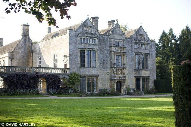 High life: Freud and Murdoch threw lavish parties at their Oxfordshire home, Burford Prior...