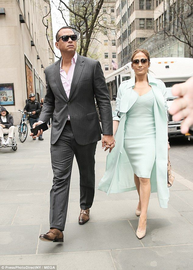 Dripping with chic: Jennifer Lopez and her boyfriend Alex Rodriguez were photographed strolling hand in hand in New York City on Monday