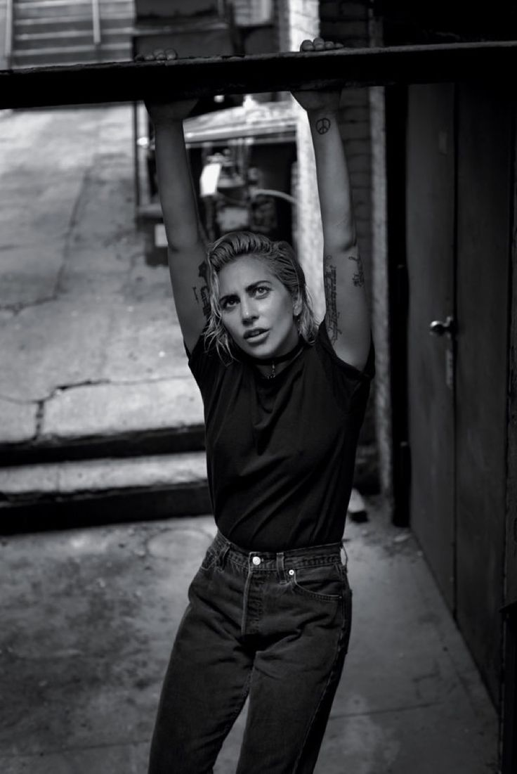 Pop star Lady Gaga poses in a candid portrait for T Magazine's October 23, 2016 cover. Photographed by Collier Schorr, the singer wears a white t-shirt with a slicked back hairstyle. Part of the magazine's 'Greats' issue, Gaga shows off a different side compared to her eccentric styles of the past. In the feature, the …