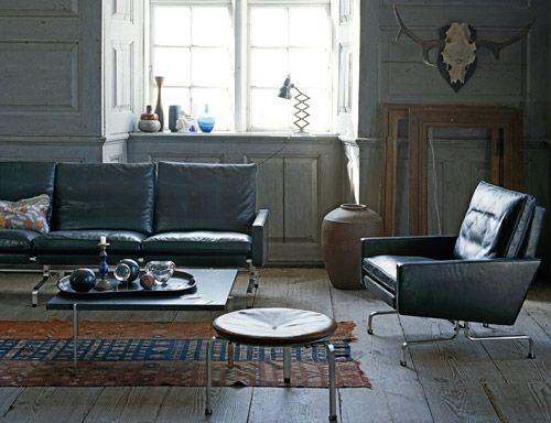 """poul kjaerholm pk31: 3-seater sofa  Design Poul Kjaerholm, 1958  Chromium-plated steel, leather, down  Made in Denmark by Fritz Hansen    """"I am trying to express the very language of the materials themselves."""" -Poul Kjærholm    The PK31 series from Fritz Hansen's """"Poul Kjaerholm collection"""" exemplifies the quality and minimalist style of Kjaerholm's designs. This series consists of the 1-seater easy chair as well as the 2-seater and 3-seater sofas.The PK31 chair and sofa series combines…"""