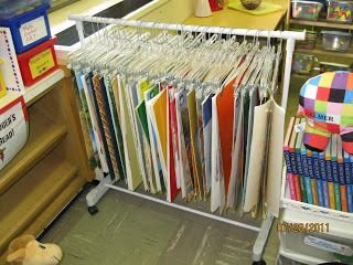 Use clothes hangers(from skirts and pants) with rubber on clips for more grip, and hang your big books from a clothes rack from Walmart or Target.
