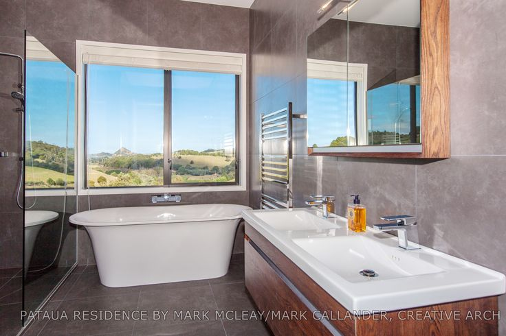 Great view from the bath! Designed by ADNZ members Mark McLeay and Mark Callander #ADNZ #bathroom #architecture