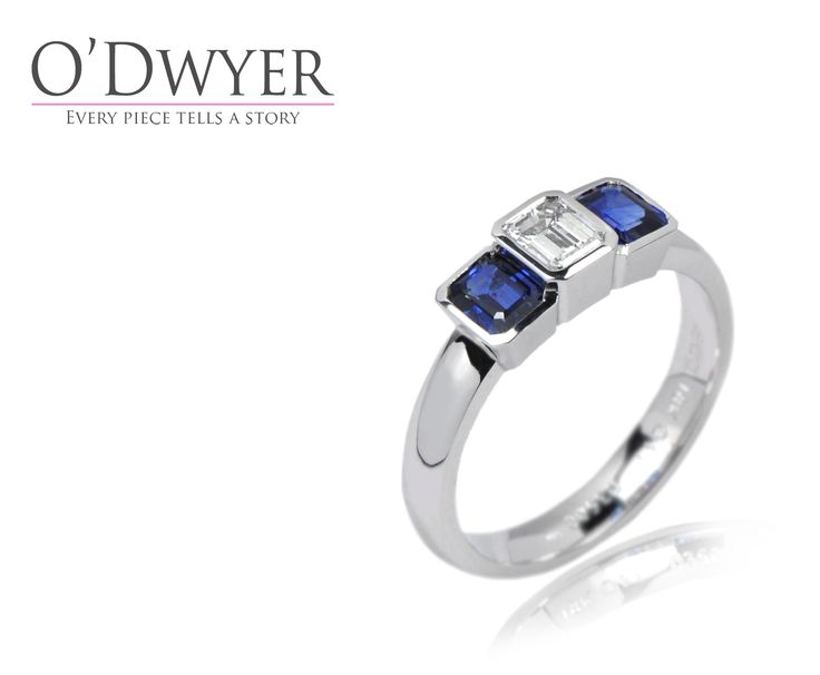 Unique Ring - 18ct white gold ring with emerald cut blue sapphires and diamond.