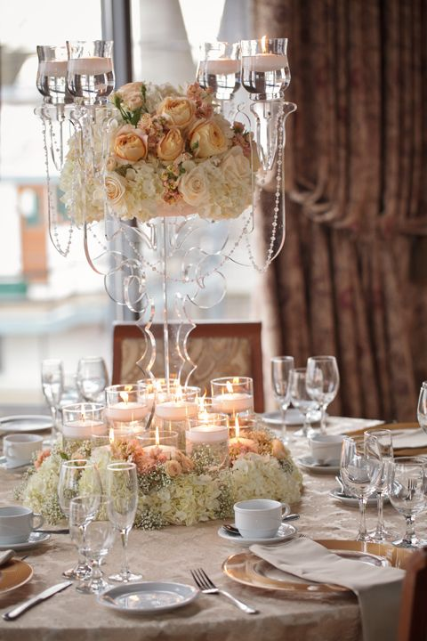 115 best images about round table centerpieces on for Glass tables for wedding reception
