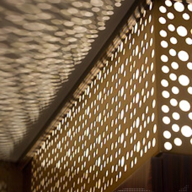 Perforated metal wall